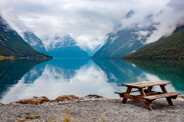 lake with wooden bench on shore
